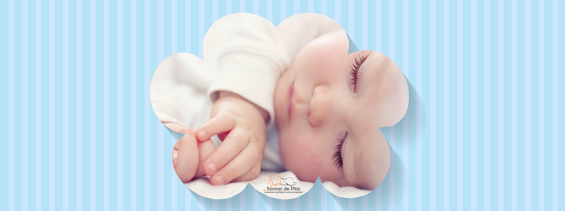 detaliu cu fata unui bebelus care doarme
